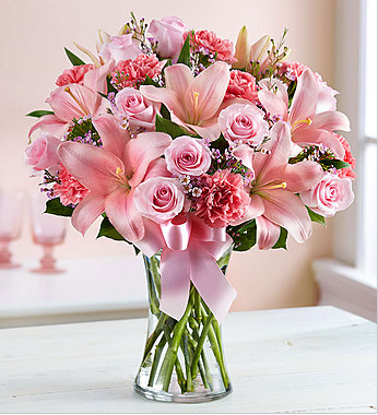 Who doesn't like pink flowers and the ribbon on the vase just gives it an extra spunk